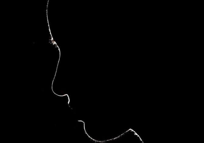 Student Services - Silhouette of person looking down.
