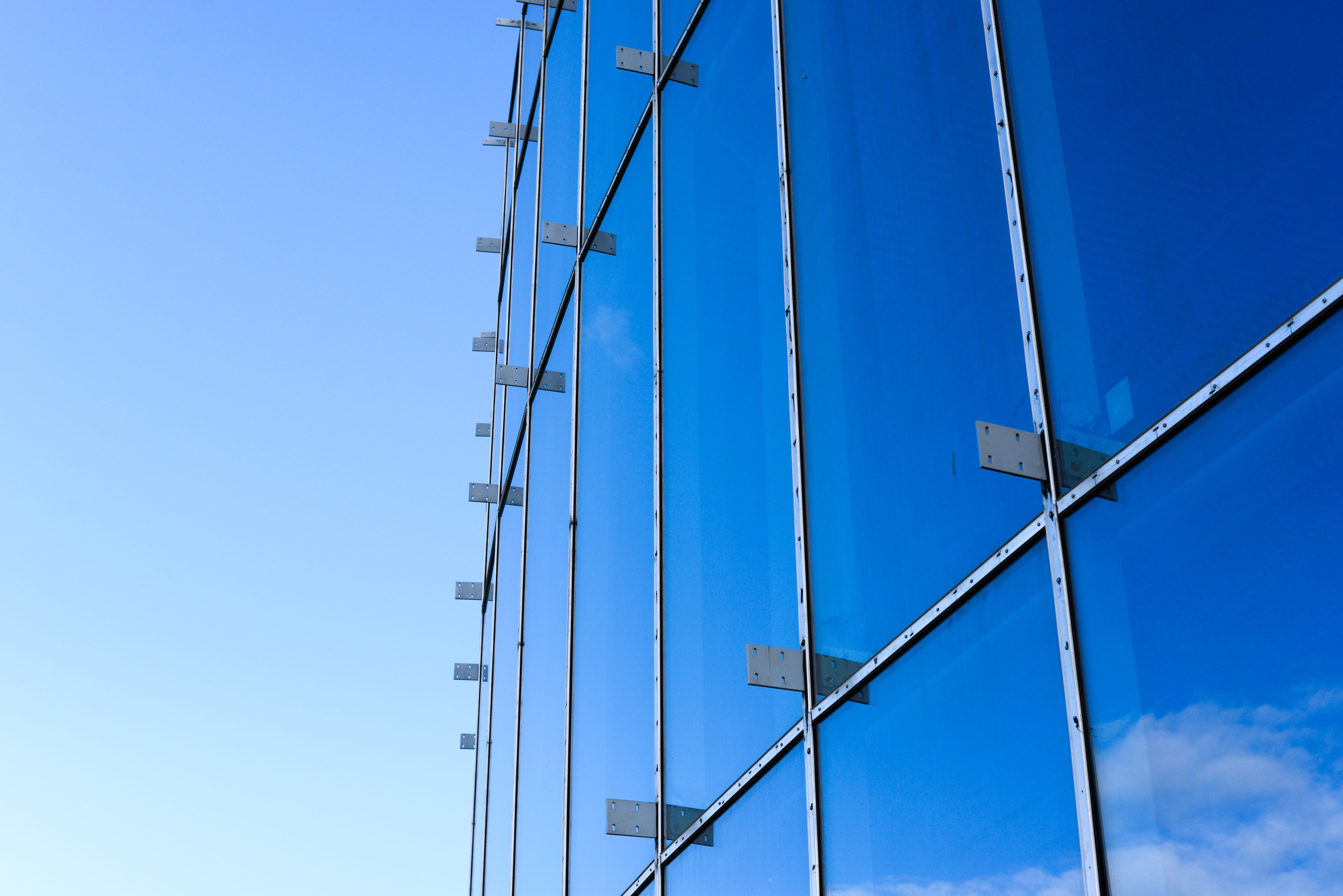 Image of large windows and a blue sky