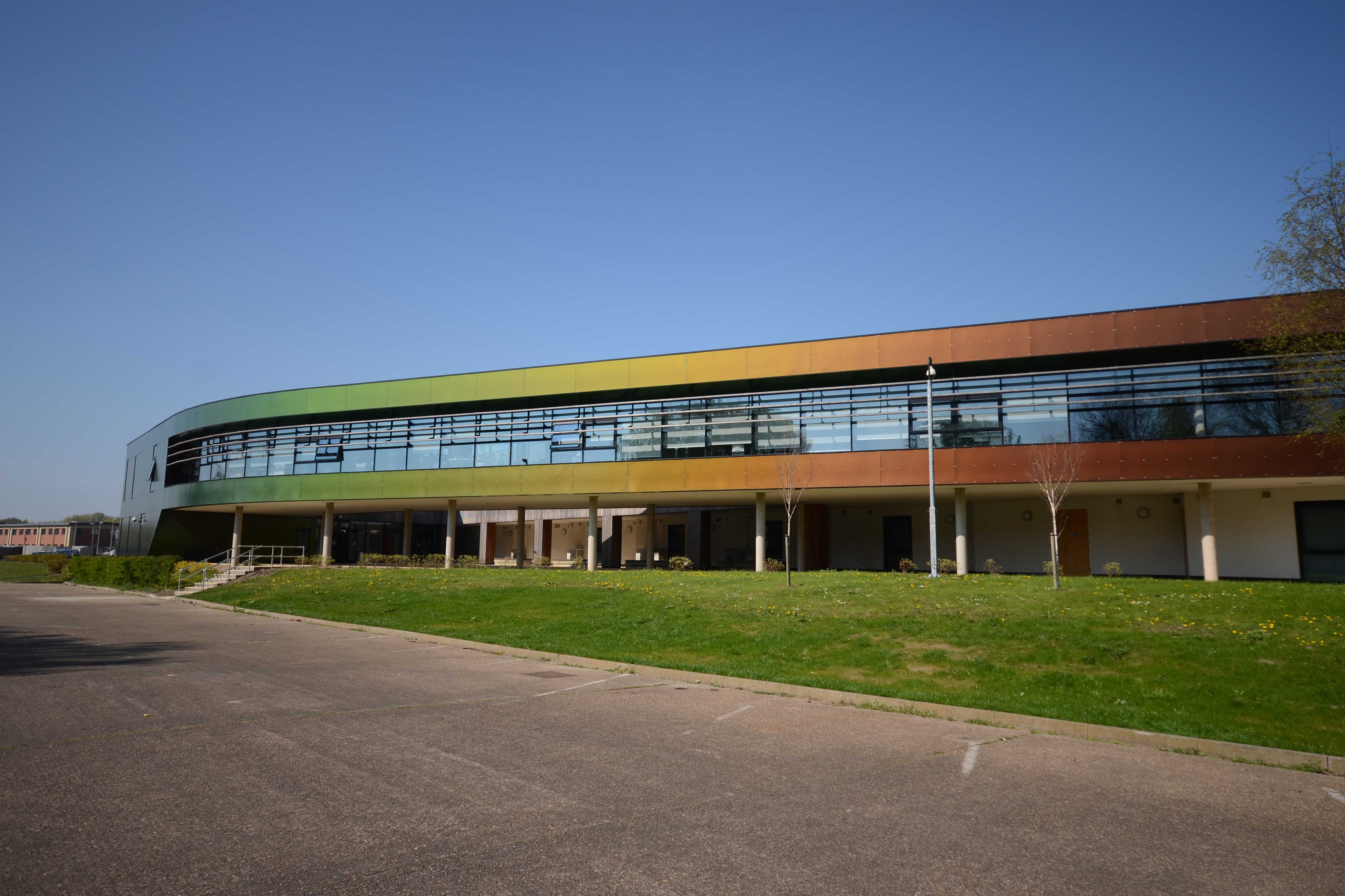 Image of long copper and green coloured building