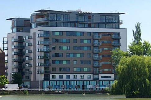 Image of a large office like building on the water