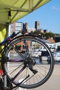 Image of a bike wheel with a church in the background