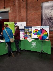 Two people stand at the Environmental stall at the University of Lincoln Refreshers Fayre
