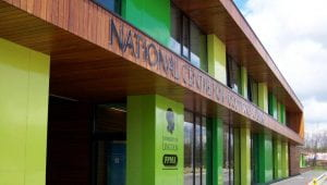 Image of a green and brown building with National Centre for Food Manufacturing across the top of it