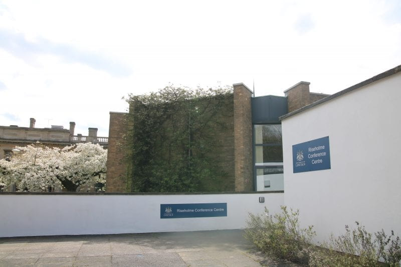Image of a white and brown circular building