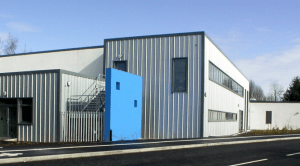 Image of a steel building with a blue wall