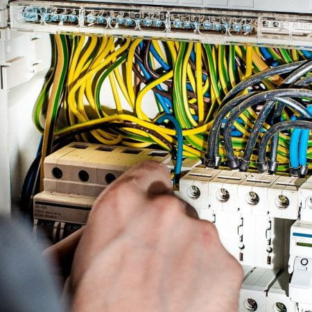 Image of an electrician working on a light board