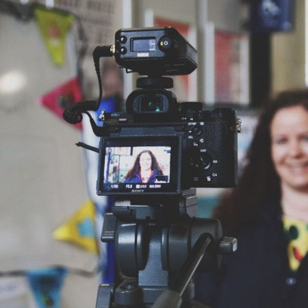Image of a person being interviewed on camera