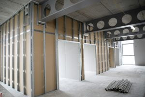 Image of a room that is under construction, the walls and ceiling bars are visible