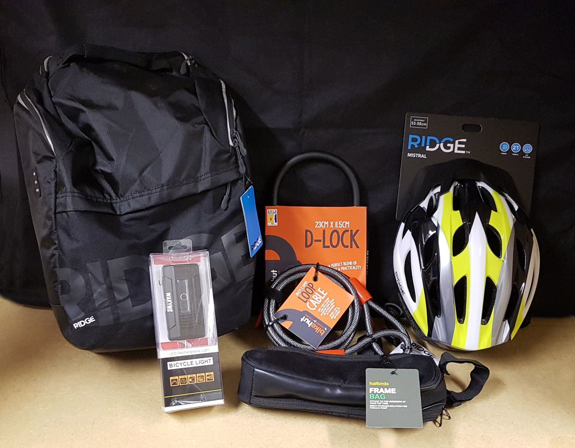 Image of cycling equipment, including a helmet, lock, lights and bag