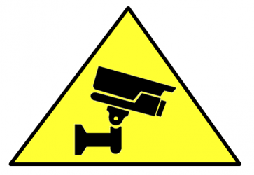 Image of a cctv sign, a camera on a yellow triangle