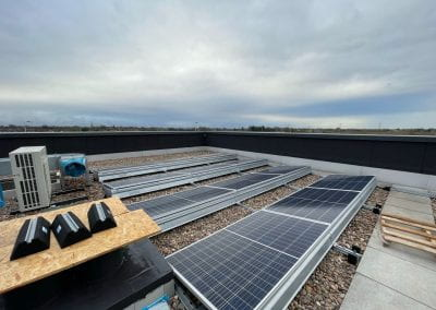 Image of a roof covered in solar panels.