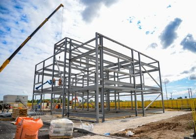 Image of a steel frame of a building on a building site