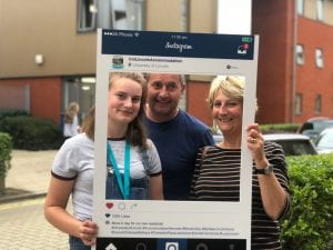 Selfie frame photos of new students & parents arriving on campus on move in weekend in 2018.
