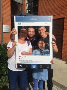 Selfie frame photos of new student & family arriving on campus on move in weekend in 2018.
