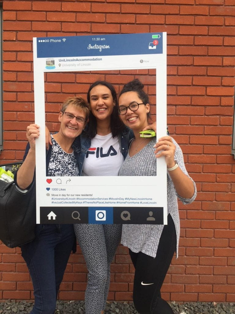 Selfie frame photos of new students & family arriving on campus on move in weekend in 2018.