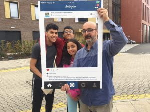 Selfie frame photos of new students & families arriving on campus on move in weekend in 2018.