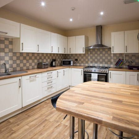 Park View kitchen complete with breakfast bar and kitchen appliances