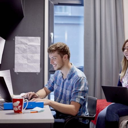 Two students studying in a studio room in The Gateway.