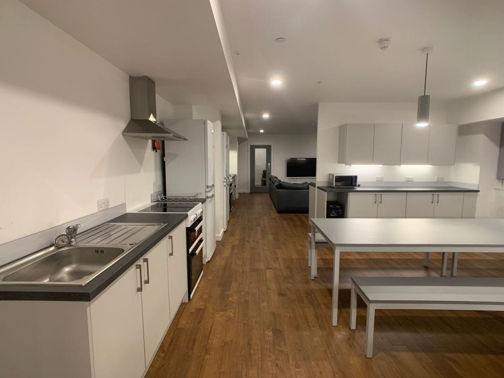 Viking House Kitchen / lounge - focus on kitchen benches and dining table. and worktop.