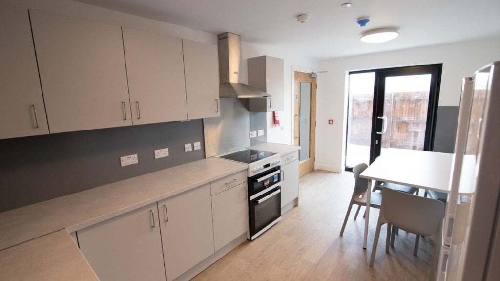 Valentine Court - example 6 bed kitchen showing worktops and kitchen table.