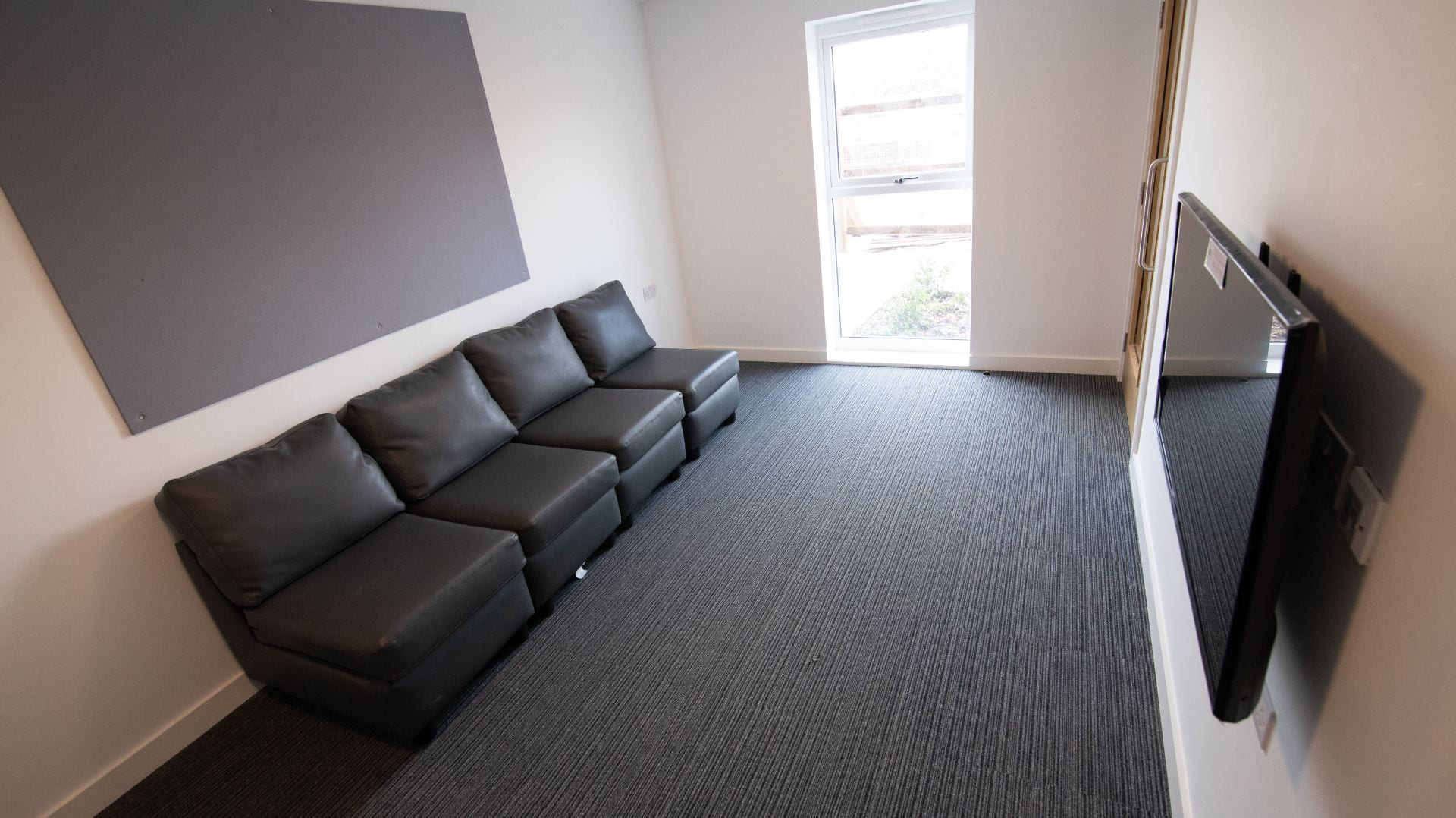 Valentine lounge with sofas and TV,