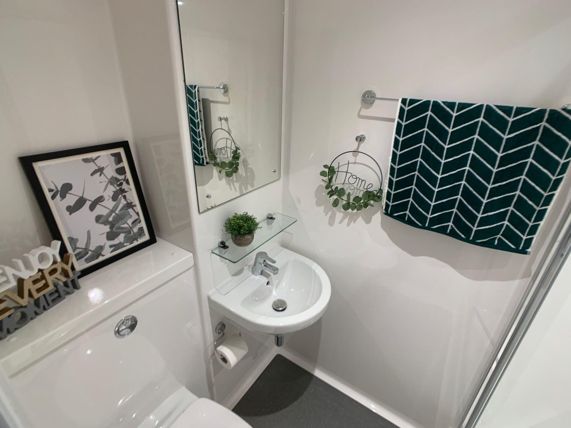 Dressed en-suite bathroom in St Marks Student Village showing toilet, sink & shower.