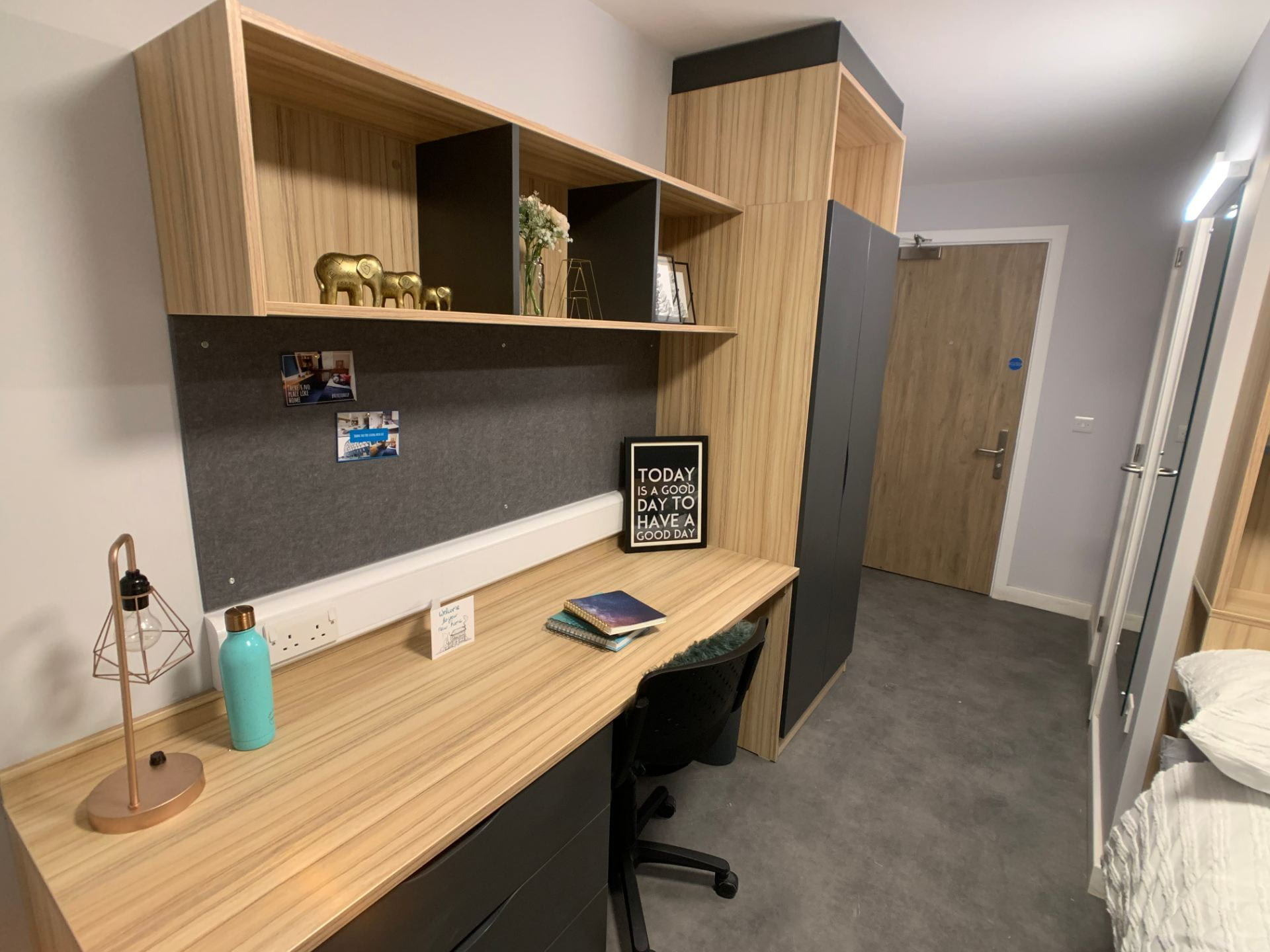 En-suite bedroom in St. Marks Student Village showing desk and wardrobe.