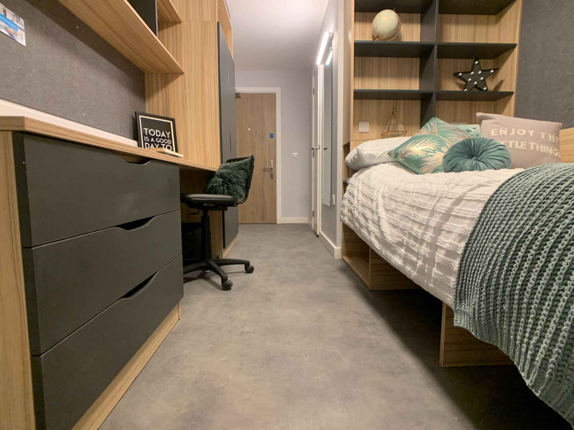 En-suite bedroom in St. Marks Student Village showing desk and small double bed.