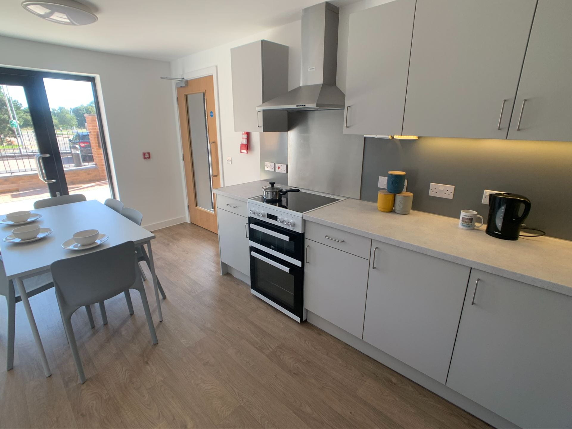 Valentine Court kitchen showing table, appliances, dining table and worktop.