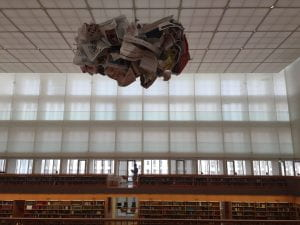 A large open room in the State Library with a paper sculpture hanging down from the ceiling