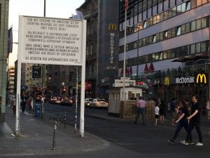 Checkpoint Charlie--a large sign post announces entry into the American Zone