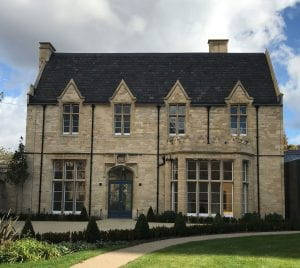 A stone building with a large ground floor bay window