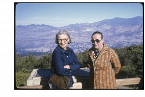 Image of two white women wearing glasses standing on a hillside