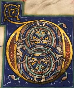 illuminated initial showing a group of lions on a background of intertwined blue vines