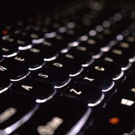 Close-up of glowing keyboard keys.