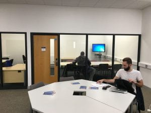 Two users working in the postgraduate study space.