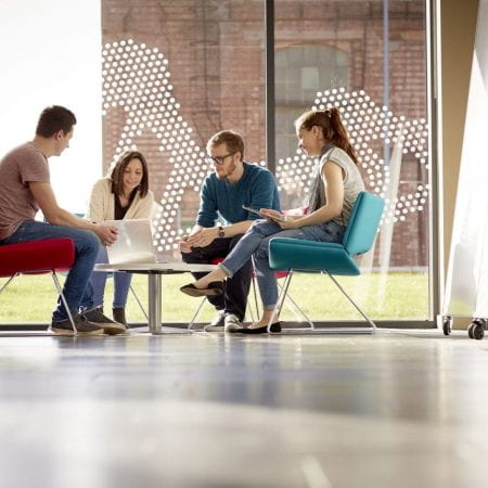 Group Discussion around coffee table.