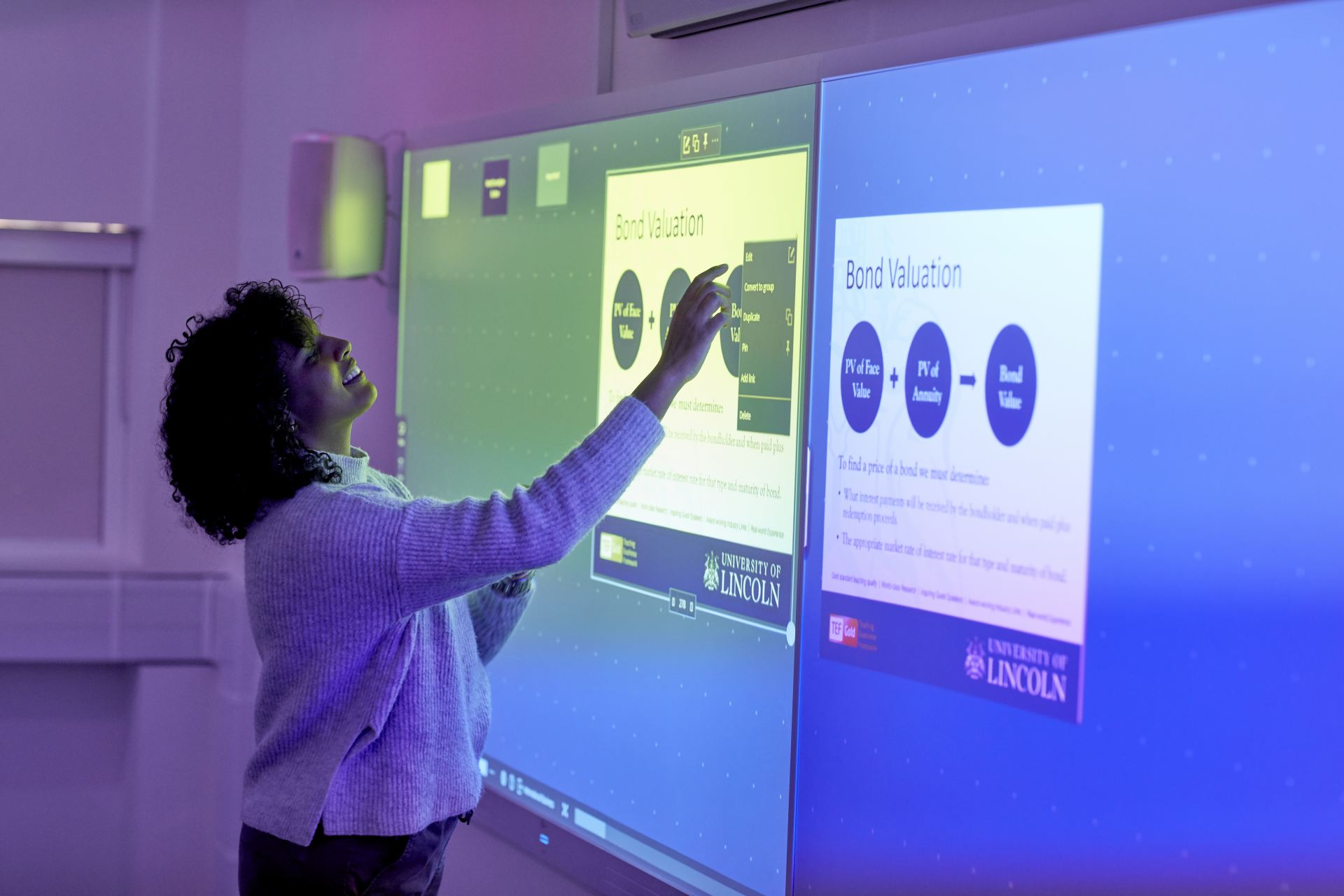 A student using the touchscreen display in the Concept Suite
