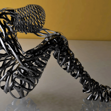 An image of a metal sculpture in the shape of a human curled up into a loose ball.