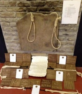 The tablets engraved with audience member initials and with the names of real past prisoners