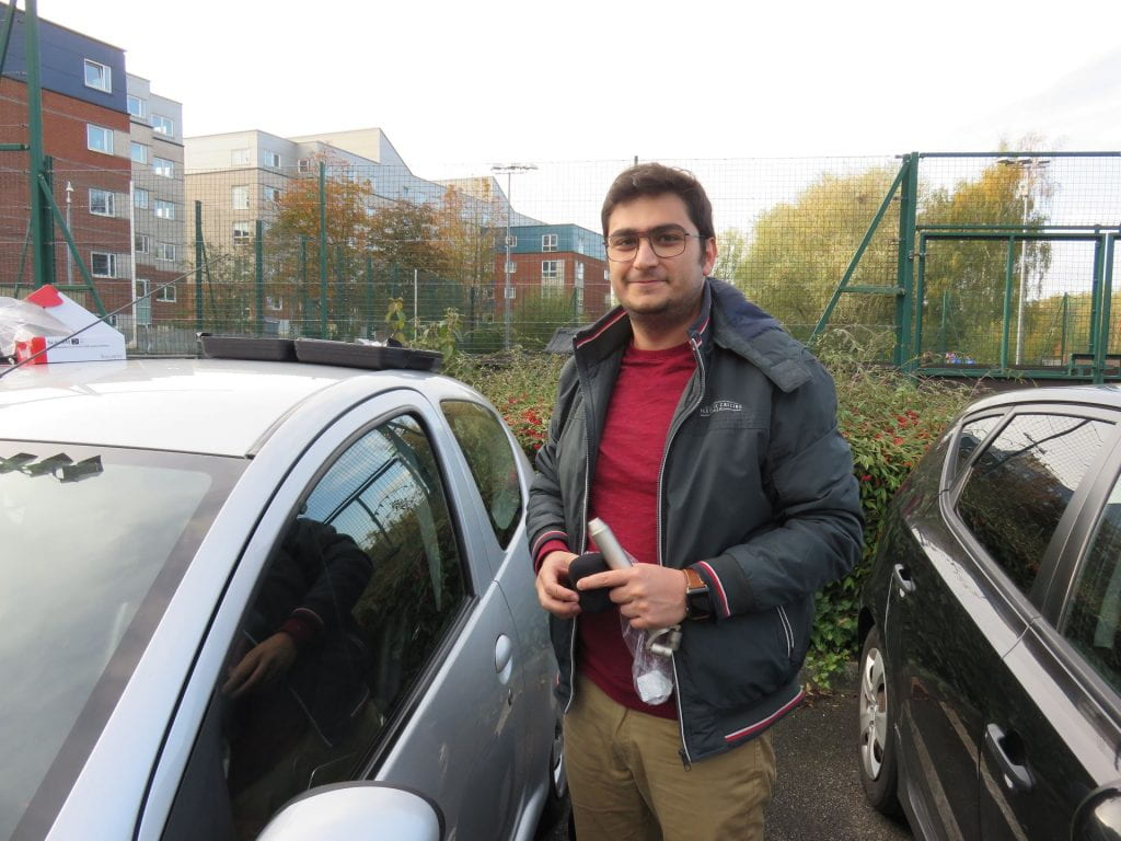 Siavash Bahrami standing by car