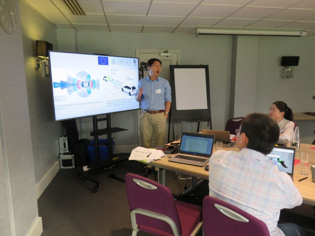 Yicheng Zhang presenting at the ULTRACEPT mid-term meeting held in Cambridge UK