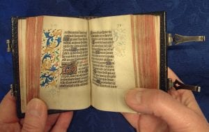 The Cathedral Librarian, Julie Taylor, holding Psalterium (St Omer)
