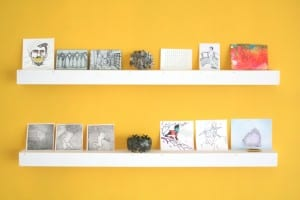 The BIG Exhibition: art works against a yellow background.