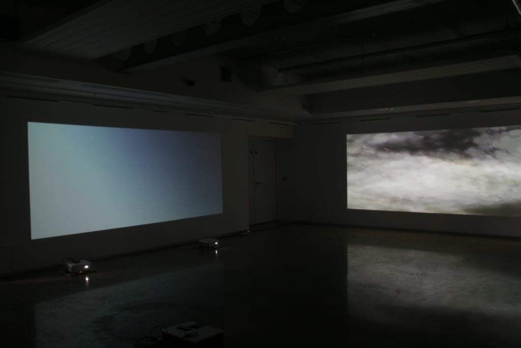 Projected film on three sides illustrated the audio.