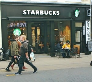 The Starbucks is becoming an international brand through globalization.