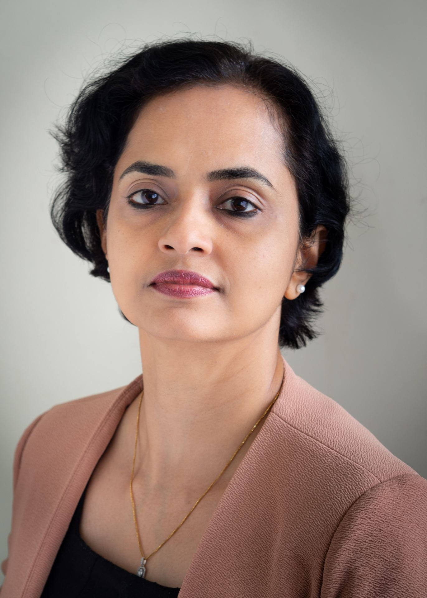 Professor Mini Saaj
