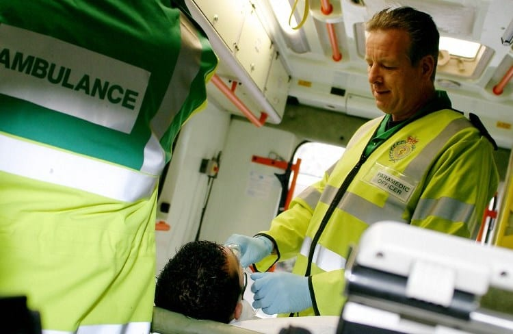 Paramedic with patient in an ambulance
