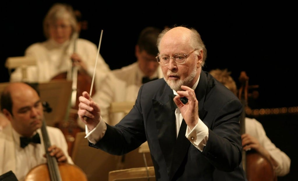 Image shows composer John Williams conducting one of his many pieces.