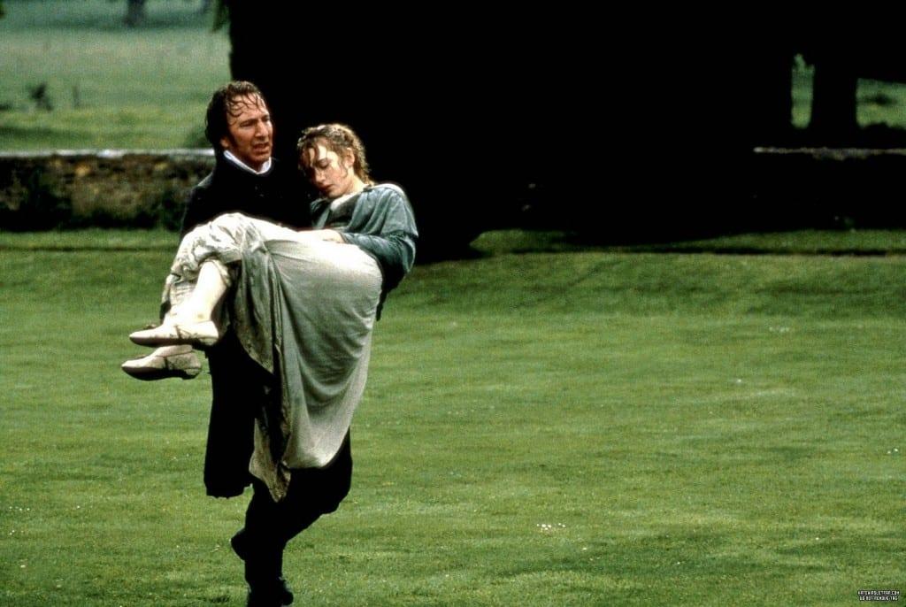 Alan RIckman carries a discheveled Kate Winslet through a grassy field
